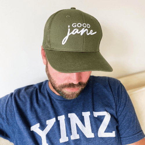 Good Jane Apparel- Person in forest green Good Jane Hat