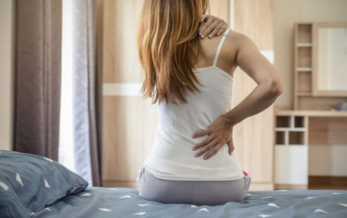 Person on Bed - CBD Alternative for Back Pain